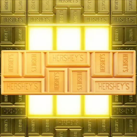 Unwrapped HERSHEY'S GOLD Bar