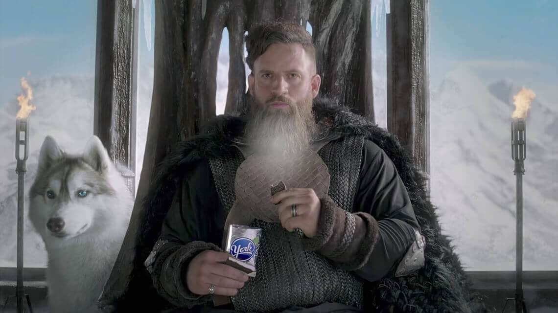 Ice Viking eating a YORK Peppermint Pattie next to a dog